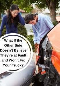 Man and woman looking at car accident damage.