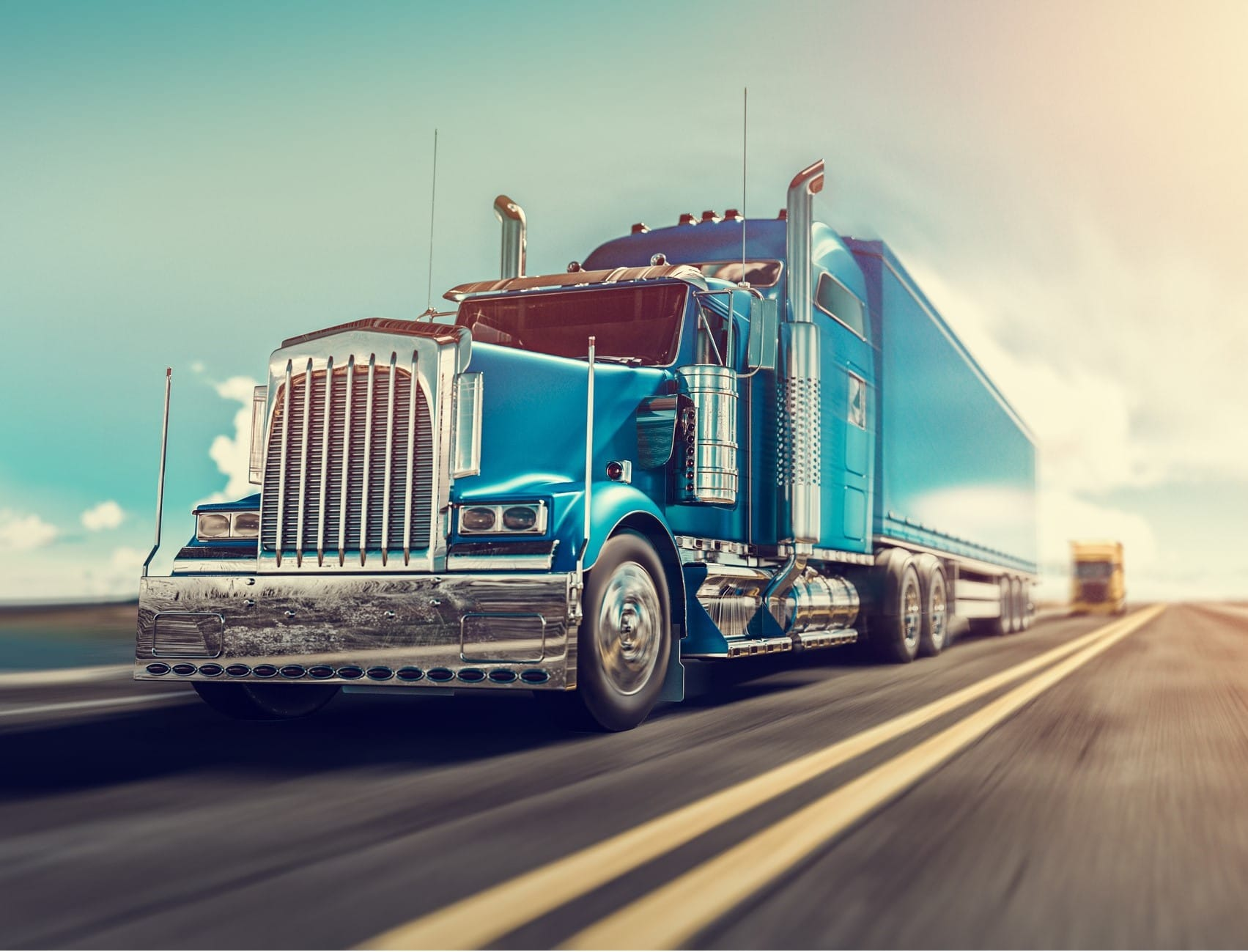 A blue semi-truck driving on highway.
