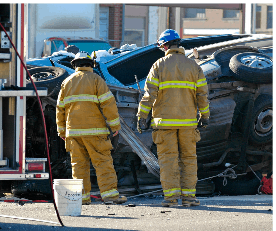 Firefighters observing automobile accident.